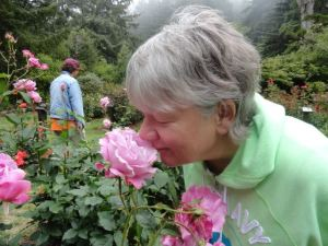 Lisa smelling the roses